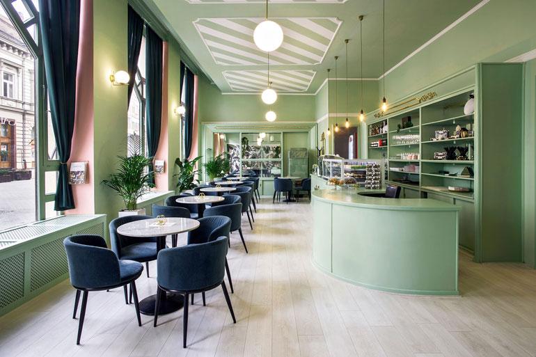 Thiết kế nội thất quán cà phê với màu xanh nhẹ nhàng
